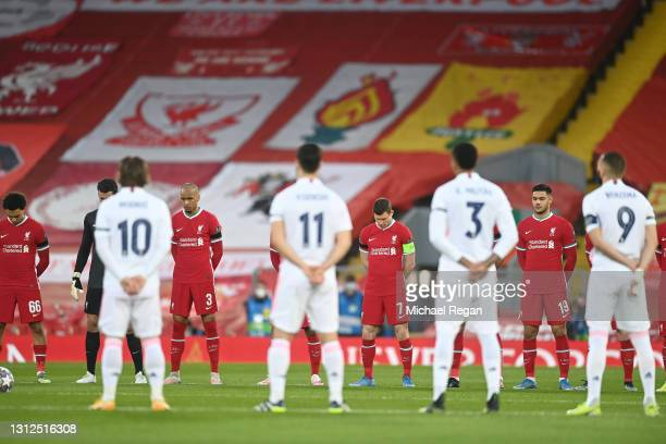 Fabinho, James Milner and Ozan Kabak of Liverpool stand for a minute's silence to remember all those who lost their lives in the Hillsborough...