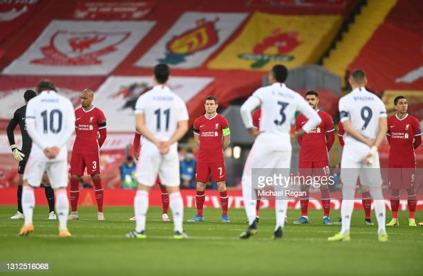 Fabinho, James Milner, Ozan Kabak and Roberto Firmino of Liverpool stand for a minute's silence to remember all those who lost their lives in the...