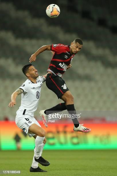 Fabinho of Athletico Paranaense jumps for a header witht Juan Manuel Insaurralde of ColoColo during a group C match of Copa CONMEBOL Libertadores...