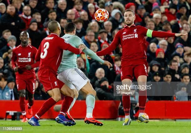 Fabinho of FC Liverpool Robert Lewandowski of Bayern Muenchen and Jordan Henderson of FC Liverpool battle for the ball during the UEFA Champions...
