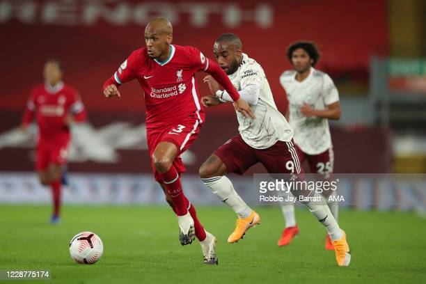 Fabinho of Liverpool and Alexandre Lacazette of Arsenal during the Premier League match between Liverpool and Arsenal at Anfield on September 28 2020...