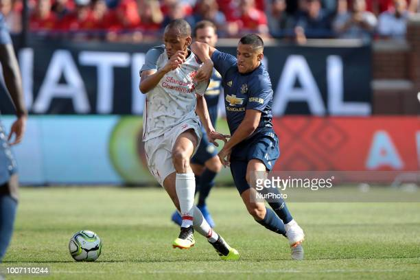 Fabinho of Liverpool and Alexi Sanchez of Manchester fight for possession of the ball during an International Champions Cup match between Manchester...