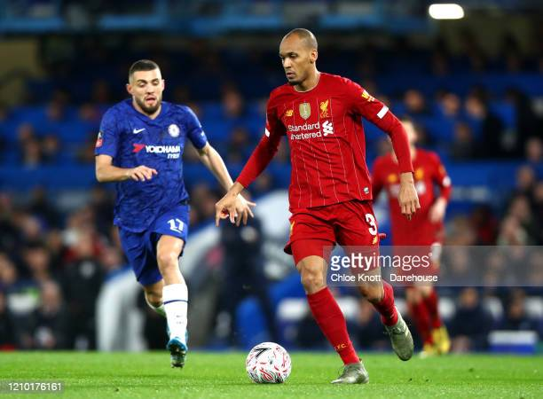 Fabinho of Liverpool and Mateo Kovacic of Chelsea FC in action during the FA Cup Fifth Round match between Chelsea FC and Liverpool FC at Stamford...