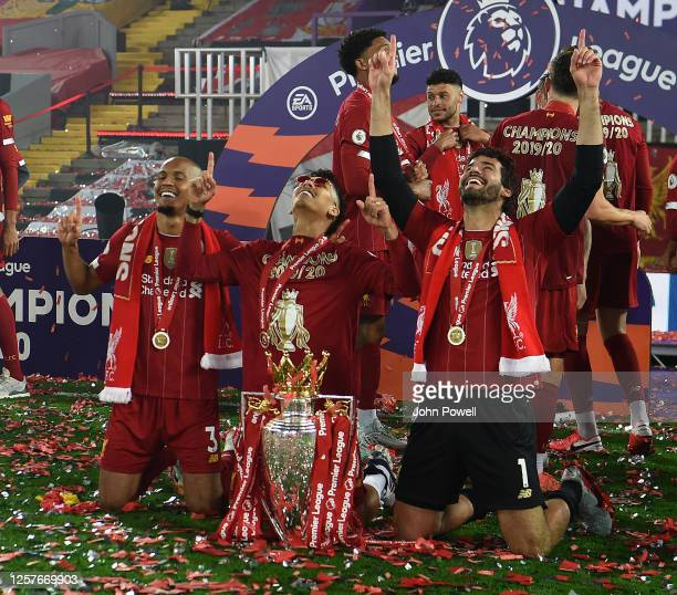 Fabinho of Liverpool and Roberto Firmino of Liverpool and Alisson Becker of Liverpool with the Premier League Trophy between Liverpool FC and Chelsea...