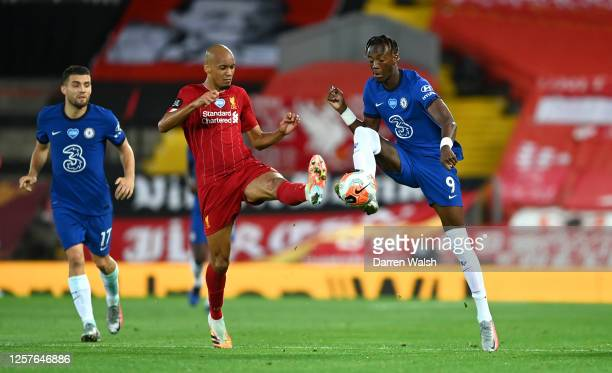 Fabinho of Liverpool and Tammy Abraham of Chelsea battle for the ball during the Premier League match between Liverpool FC and Chelsea FC at Anfield...