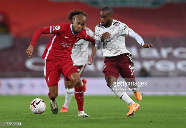 Fabinho of Liverpool battles for possession with Alexandre Lacazette of Arsenal during the Premier League match between Liverpool and Arsenal at...