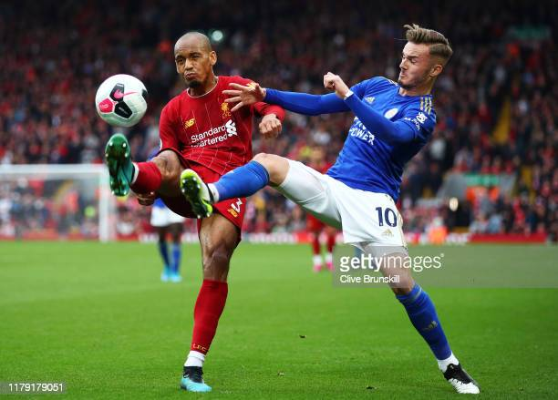 Fabinho of Liverpool battles for possession with James Maddison of Leicester City during the Premier League match between Liverpool FC and Leicester...
