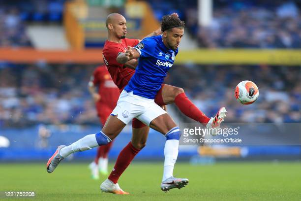 Fabinho of Liverpool battles with Dominic Calvert-Lewin of Everton during the Premier League match between Everton FC and Liverpool FC at Goodison...