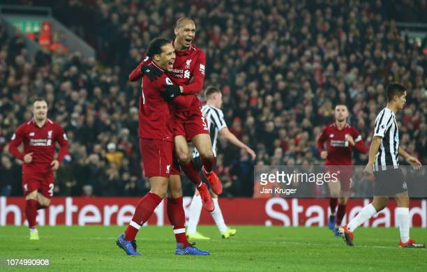 Fabinho of Liverpool celebrates after scoring his team's fourth goal with team mate Virgil van Dijk during the Premier League match between Liverpool...