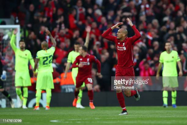 Fabinho of Liverpool celebrates as Divock Origi scores his team's first goal during the UEFA Champions League Semi Final second leg match between...