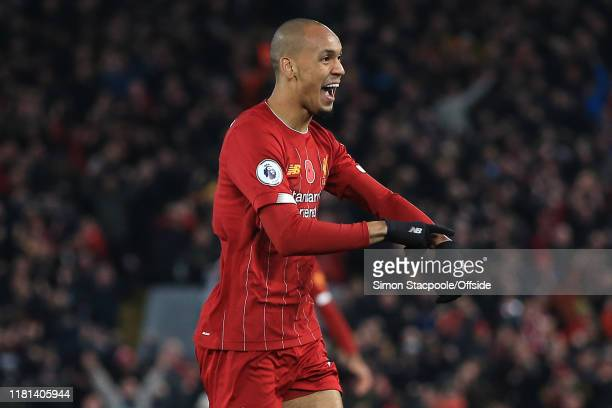Fabinho of Liverpool celebrates scoring the opening goal by tapping his wrist during the Premier League match between Liverpool FC and Manchester...