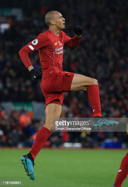 Fabinho of Liverpool celebrates scoring the opening goal during the Premier League match between Liverpool FC and Manchester City at Anfield on...