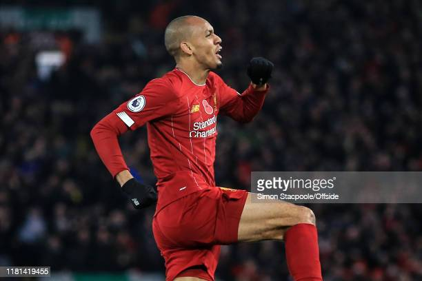 Fabinho of Liverpool celebrates scoring their 1st goal during the Premier League match between Liverpool FC and Manchester City at Anfield on...