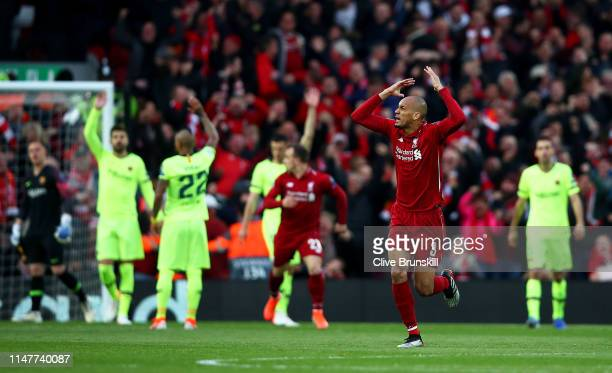 Fabinho of Liverpool celebrates to the crowd after his team mate Divock Origi has scored the first goal during the UEFA Champions League Semi Final...