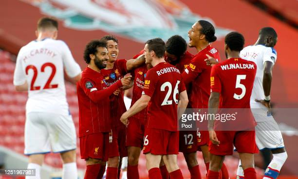 Fabinho of Liverpool celebrates with his team after scoring his sides third goal during the Premier League match between Liverpool FC and Crystal...