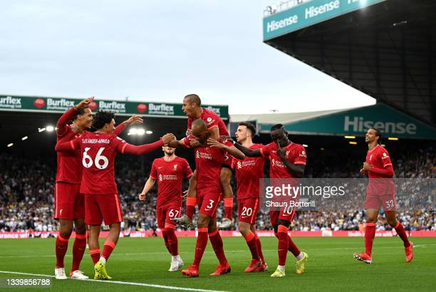 Fabinho of Liverpool celebrates with Thiago Alcantara and team mates after scoring their side's second goal during the Premier League match between...
