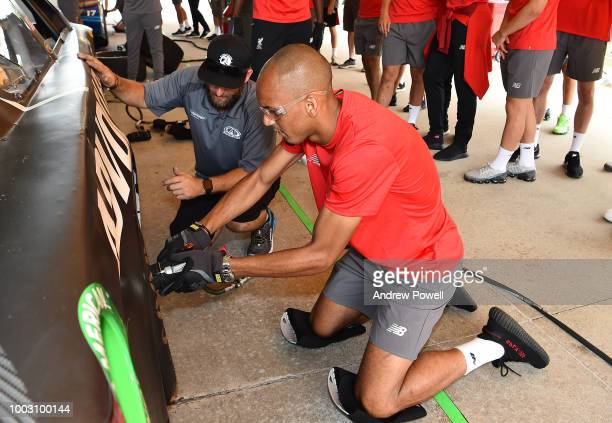 Fabinho of Liverpool changing tyres during a tour of Roush Fenway Racing on July 21 2018 in Charlotte North Carolina