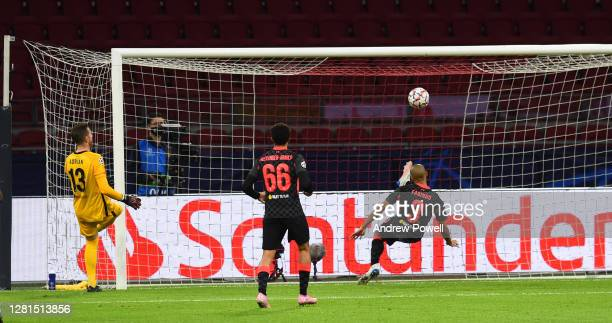 Fabinho of Liverpool cleares the liverpool line during the UEFA Champions League Group D stage match between Ajax Amsterdam and Liverpool FC at Johan...