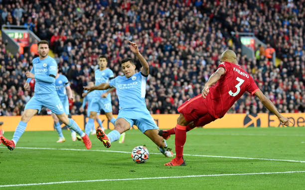 Fabinho of Liverpool has a shot blocked by Rodrigo of Manchester City during the Premier League match between Liverpool and Manchester City at...