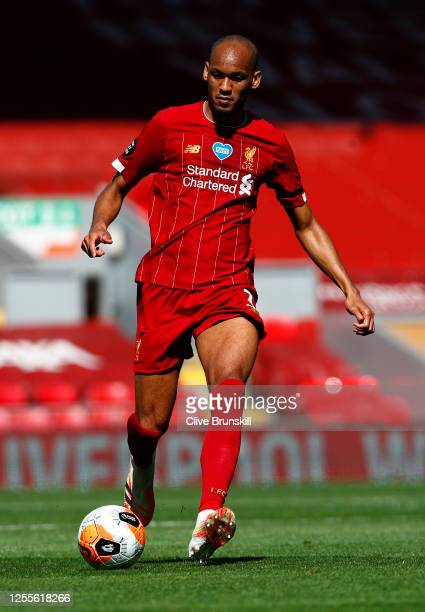 Fabinho of Liverpool in action with the ball during the Premier League match between Liverpool FC and Burnley FC at Anfield on July 11 2020 in...