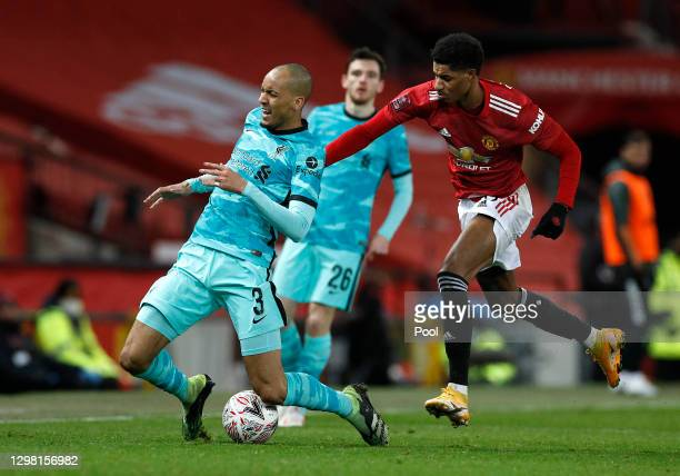 Fabinho of Liverpool is challenged by Marcus Rashford of Manchester United during The Emirates FA Cup Fourth Round match between Manchester United...