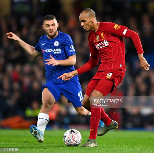 Fabinho of Liverpool is closed down by Mateo Kovacic of Chelsea during the FA Cup Fifth Round match between Chelsea FC and Liverpool FC at Stamford...