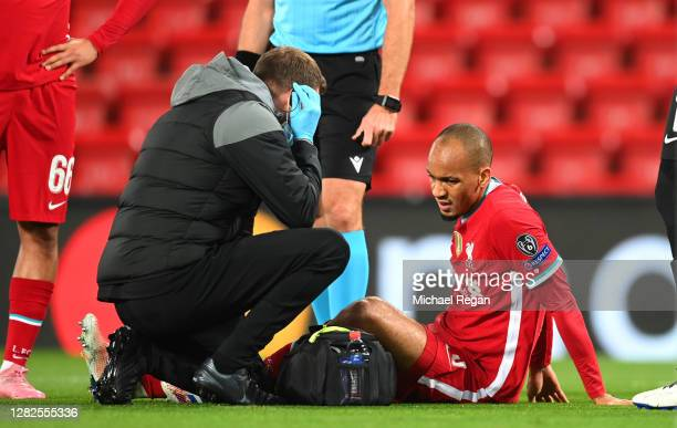 Fabinho of Liverpool is seen to by medical staff after sustaining an injury during the UEFA Champions League Group D stage match between Liverpool FC...