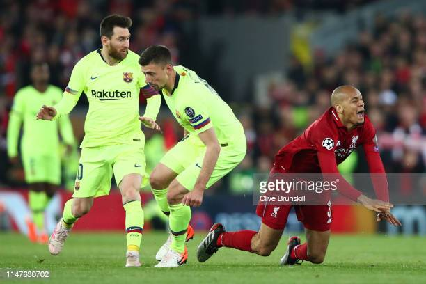 Fabinho of Liverpool is stopped Lionel Messi and Clement Lenglet of Barcelona during the UEFA Champions League Semi Final second leg match between...