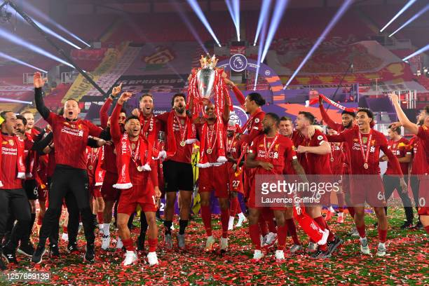 Fabinho of Liverpool lifts The Premier League trophy following the Premier League match between Liverpool FC and Chelsea FC at Anfield on July 22,...