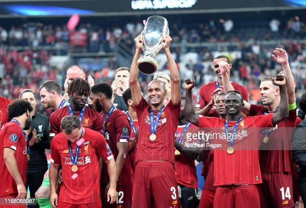 Fabinho of Liverpool lifts the UEFA Super Cup trophy as Liverpool celebrate victory following the UEFA Super Cup match between Liverpool and Chelsea...