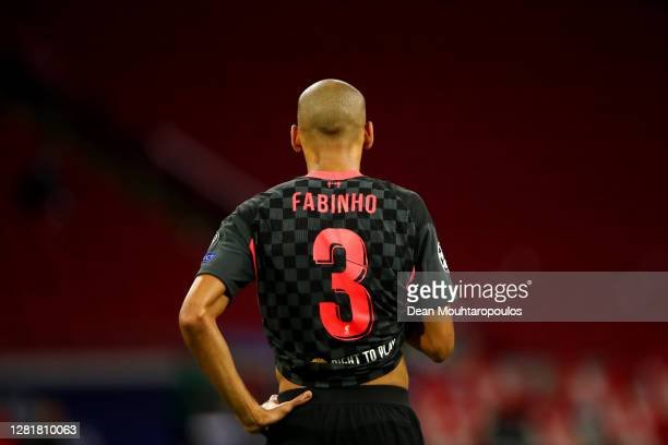 Fabinho of Liverpool looks on during the UEFA Champions League Group D stage match between Ajax Amsterdam and Liverpool FC at Johan Cruijff Arena on...