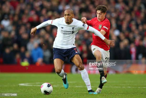 Fabinho of Liverpool looks to break past Daniel James of Manchester United during the Premier League match between Manchester United and Liverpool FC...