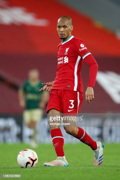 Fabinho of Liverpool passes the ball during the Premier League match between Liverpool and Sheffield United at Anfield on October 24, 2020 in...