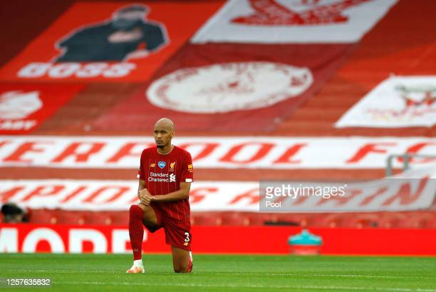 Fabinho of Liverpool takes a knee in support of the Black Lives Matter movement prior to the Premier League match between Liverpool FC and Chelsea FC...