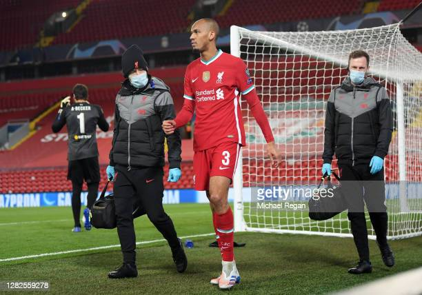 Fabinho of Liverpool walks around the pitch after he sustains an injury during the UEFA Champions League Group D stage match between Liverpool FC and...