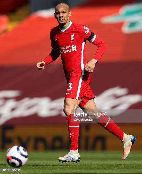 Fabinho of Liverpool watches the ball during the Premier League match between Liverpool and Aston Villa at Anfield on April 10, 2021 in Liverpool,...