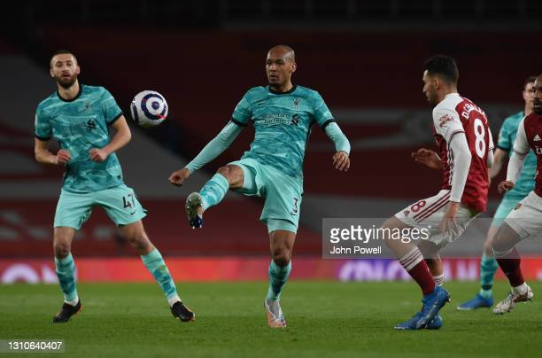 Fabinho of Liverpool with Dani Ceballos of Arsenal during the Premier League match between Arsenal and Liverpool at Emirates Stadium on April 03,...