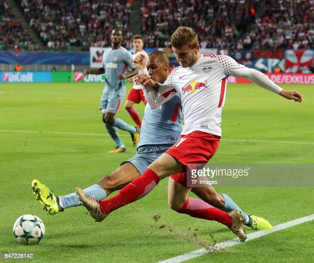 Fabinho of Monaco and Timo Werner of Leipzig battle for the ball during the UEFA Champions League group G match between RB Leipzig and AS Monaco at...