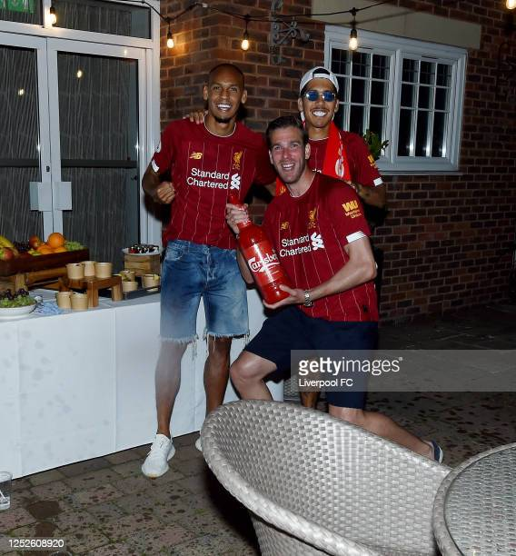 Fabinho, Roberto Firmino and Adrian of Liverpool celebrating winning the Premier League on June 25, 2020 in Liverpool, England.