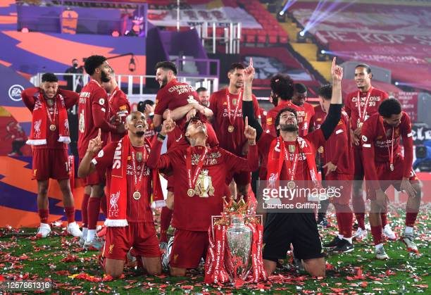 Fabinho, Roberto Firmino and Alisson Becker of Liverpool celebrate with The Premier League trophy following the Premier League match between...