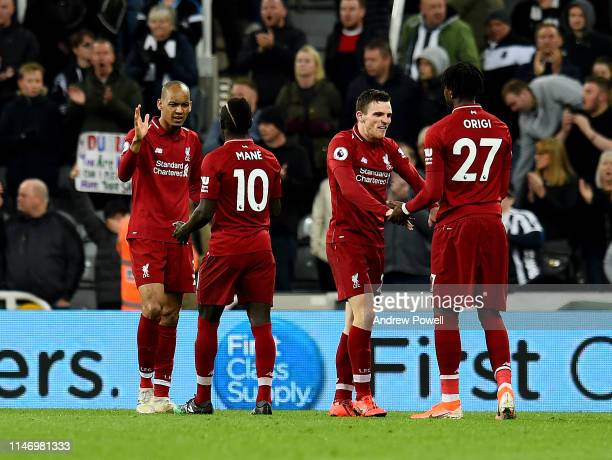 Fabinho Sadio Mane Andy Robertson and Divock Origi of Liverpool embraces at the end of the game the Premier League match between Newcastle United and...
