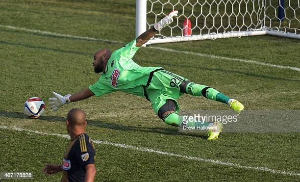 Fabinho watches as teammate Rais Mbolhi of Philadelphia Union is unable to make a save on the second goal of the second half during the game against...