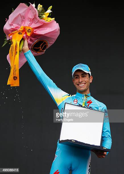 Fabio Aru of Italy and team Astana celebrates his third place finish after the twentyfirst stage of the 2014 Giro d'Italia a 172km stage between...