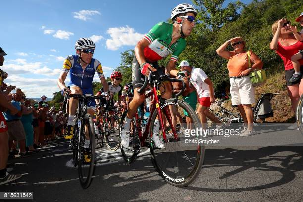 Fabio Aru of Italy riding for Astana Pro Team and Daniel Martin of Ireland riding for QuickStep Floors ride in the peloton during stage 15 of the...