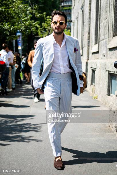 Fabio Attanasio, wearing a light blue and white striped suit, white shirt and brown loafers, is seen outside Pal Zileri show, during the Milan Men's...