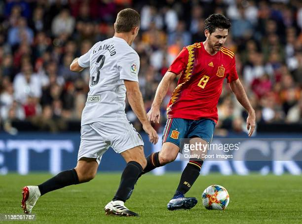 Fabio Aurelio of Valencia Legends competes for the ball with Victor Sanchez Del Amo of Spain Legends during the friendly match of the celebrations of...