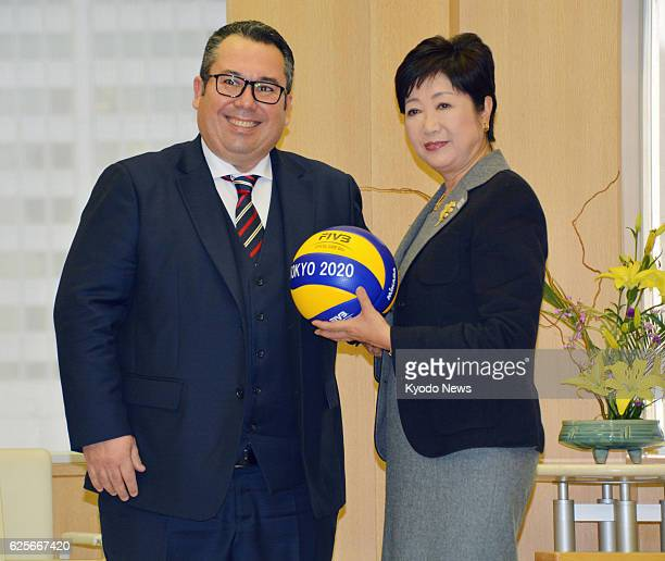 Fabio Azevedo general director of volleyball's world governing body FIVB gives a volleyball to Tokyo Gov Yuriko Koike at the Tokyo metropolitan...
