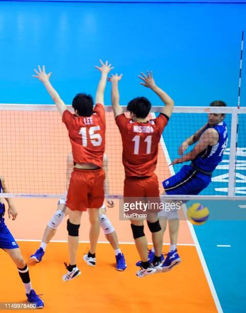 Fabio Balaso Italy v Haku Ri and Yuji Nishida Japan during Mens Volleyball Nations League VNL game between Japan and Italy at Palace of Culture and...