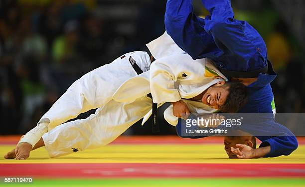 Fabio Basile of Italy and Adrian Gomboc of Slovenia compete during the Men's 66kg semi final on Day 2 of the Rio 2016 Olympic Games at Carioca Arena...