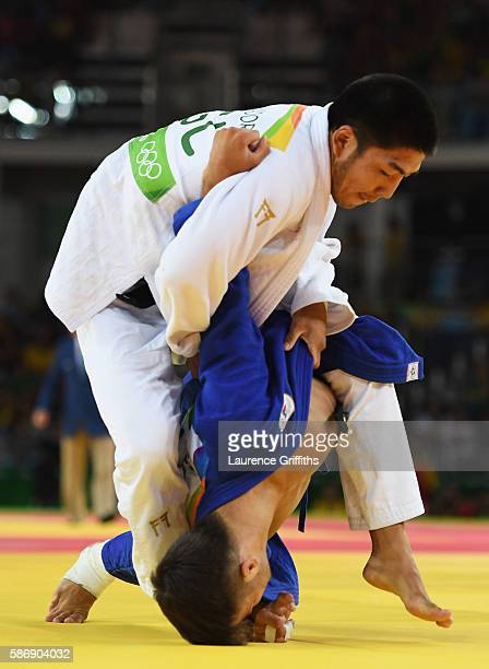 Fabio Basile of Italy and Tumurkhuleg Davaadorj of Mongolia compete during the Men's 66kg quarter final on Day 2 of the Rio 2016 Olympic Games at...